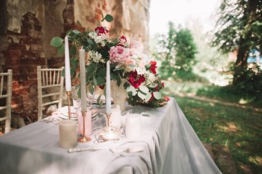 beautiful wedding table with candles in the garden.