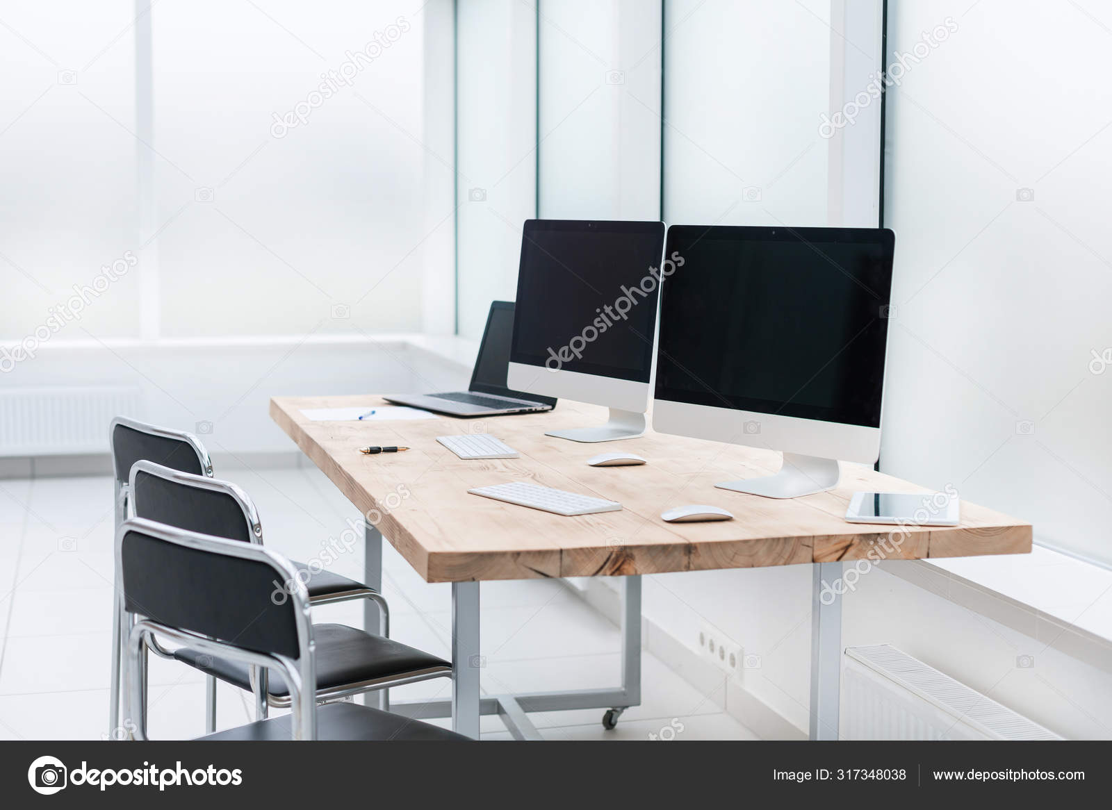 Workplace With Computers On The Table In An Empty Office Stock Photo C Albertyurolaits 317348038