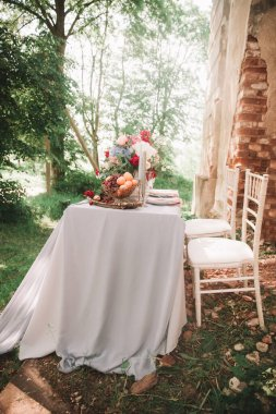 Decorated wedding table with candles in the garden.