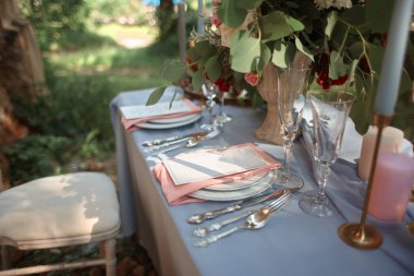 close up. wedding table on the background of nature.