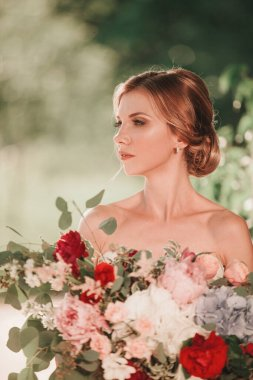 bride in wedding dress on blurred nature background . holidays and events