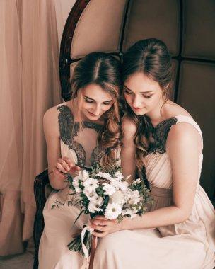 close up. bridesmaids looking at wedding bouquet