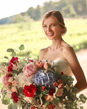 portrait of happy bride on blurred Park background .