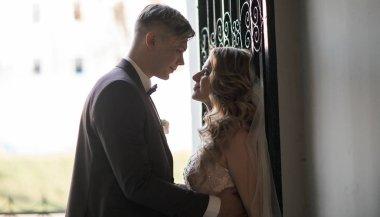 bride and groom talking standing near the door