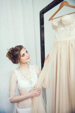 happy girl trying on her wedding dress