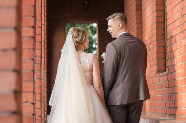 close up. bride and groom on a walk .