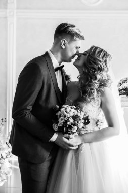black and white photo. portrait of a happy bride and groom.