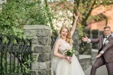 very happy bride and groom on a big city street.