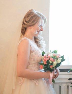 happy bride girl looking through the window