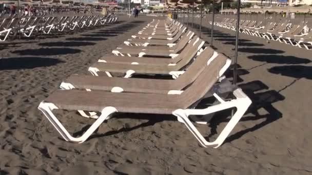 Beach lounges on sand