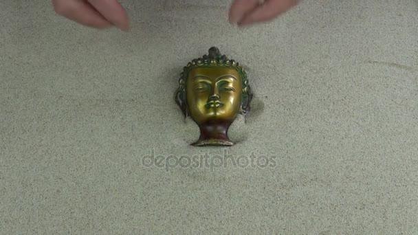 Karet, zen zahrada s mini hrábě písek a socha Buddhy