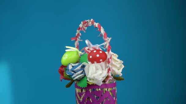 Rotating beautiful easter basket made from paper and eggs on blue rotating beautiful easter basket made from paper and eggs on blue background 4k stock footage rotating beautiful colorful easter basket negle Gallery