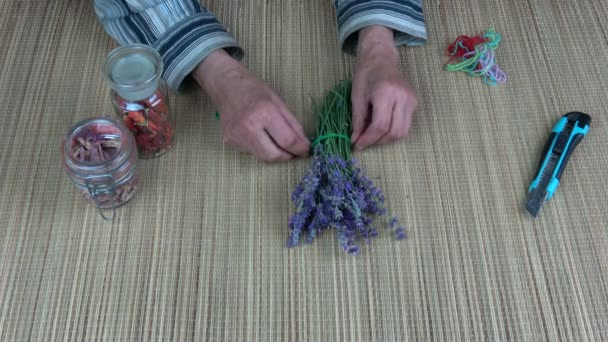 Old woman herbalist binding lavender bunch