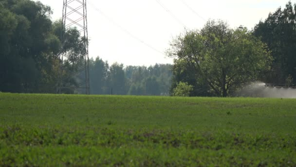 Farmer tractor spraying crop  field
