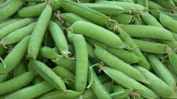 rotierende frische grüne Erbsenschoten Lebensmittel Hintergrund