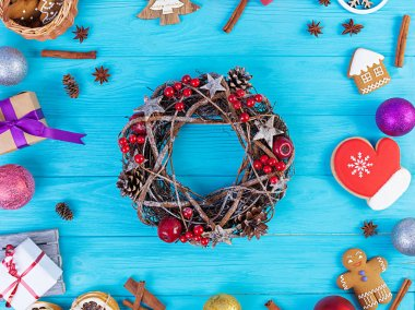 Christmas background. Christmas gift, toys, gingerbread cookies, spices and decorations on wooden background. Top view