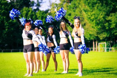 Cheerleaders Practicing Outdoors