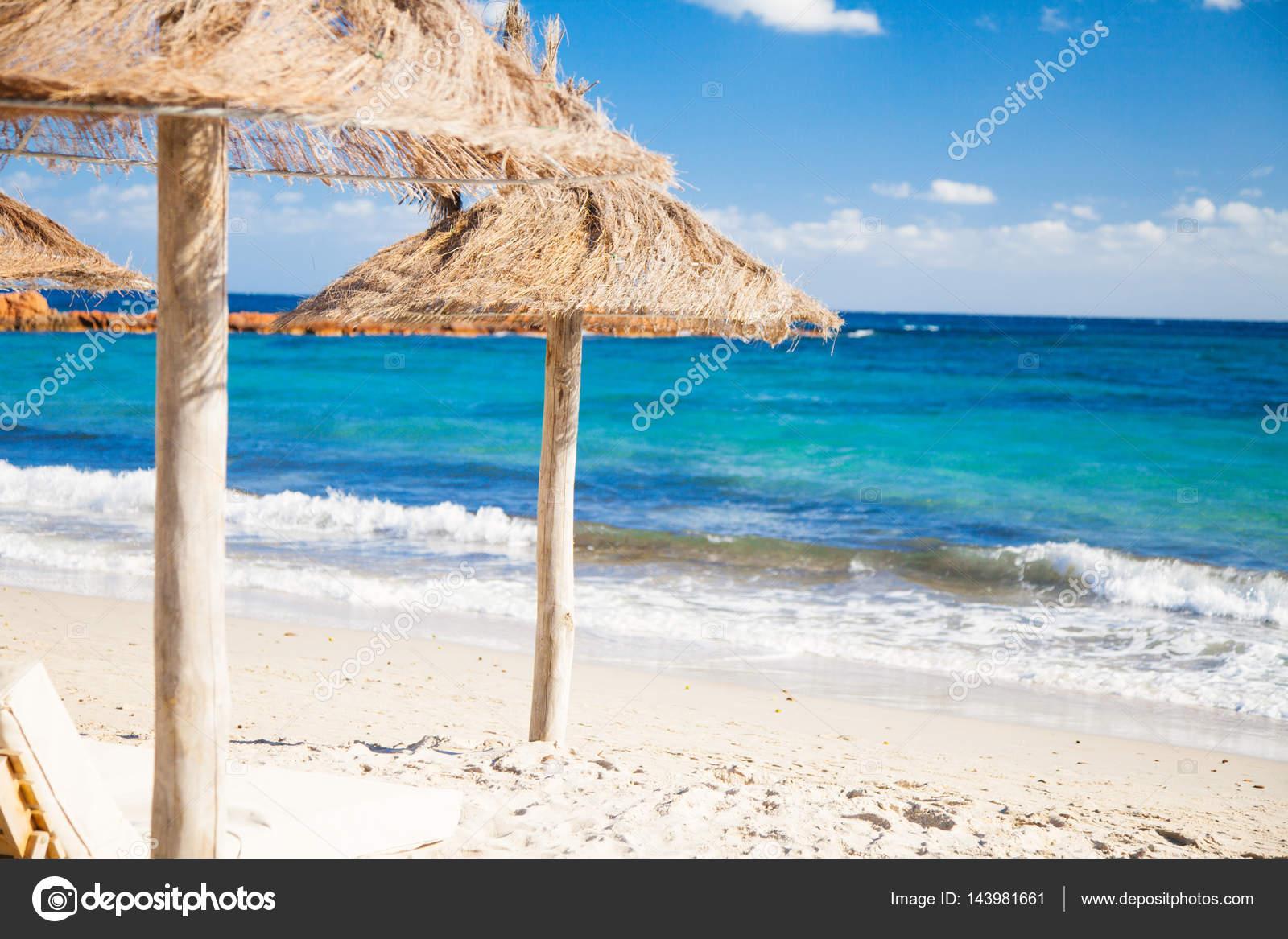 Beach Parasols in Corsica — Stock Photo © nullplus  143981661 2accaecfc61