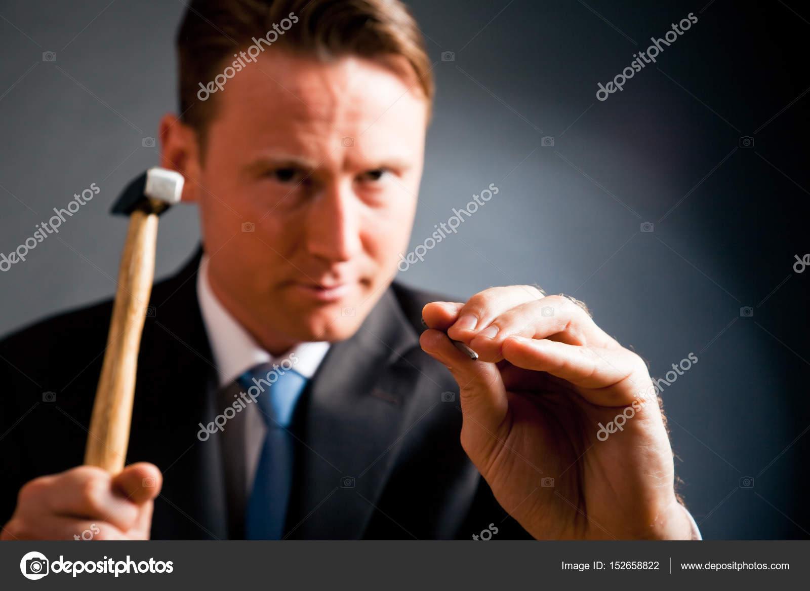 Business Man hitting Nail On The Head — Stock Photo © nullplus ...