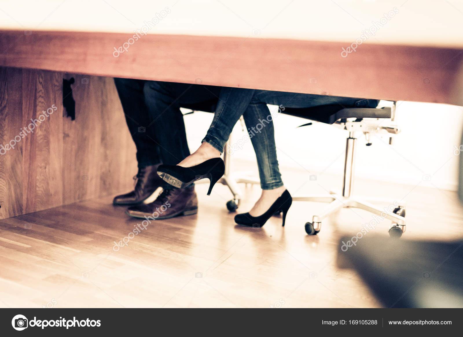 Feet under the table