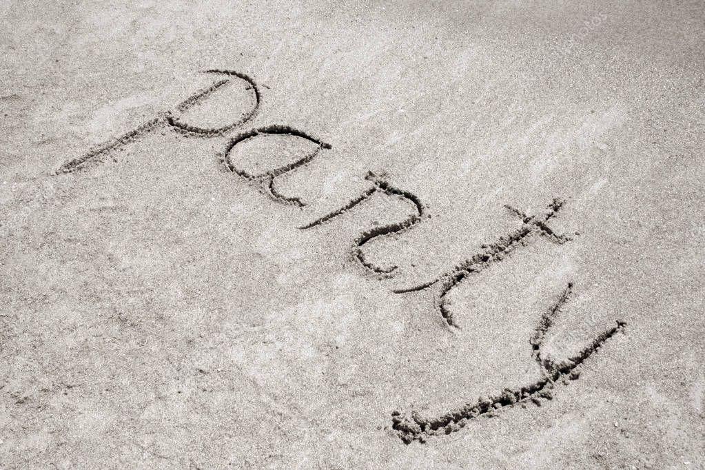 Party handwritten in sand