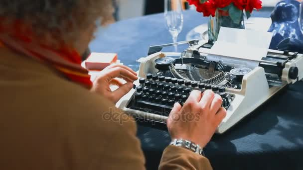Vintage writer desk style, he is working and typing on his typewriter