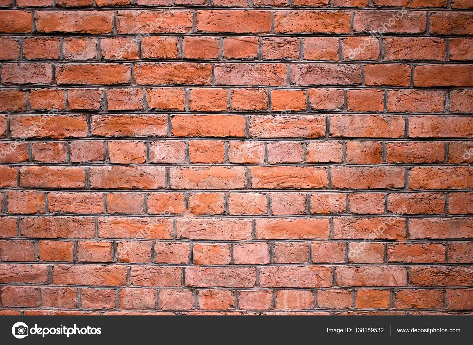 mur de brique rouge extrieur urbain tann surface comme toile de fond photo