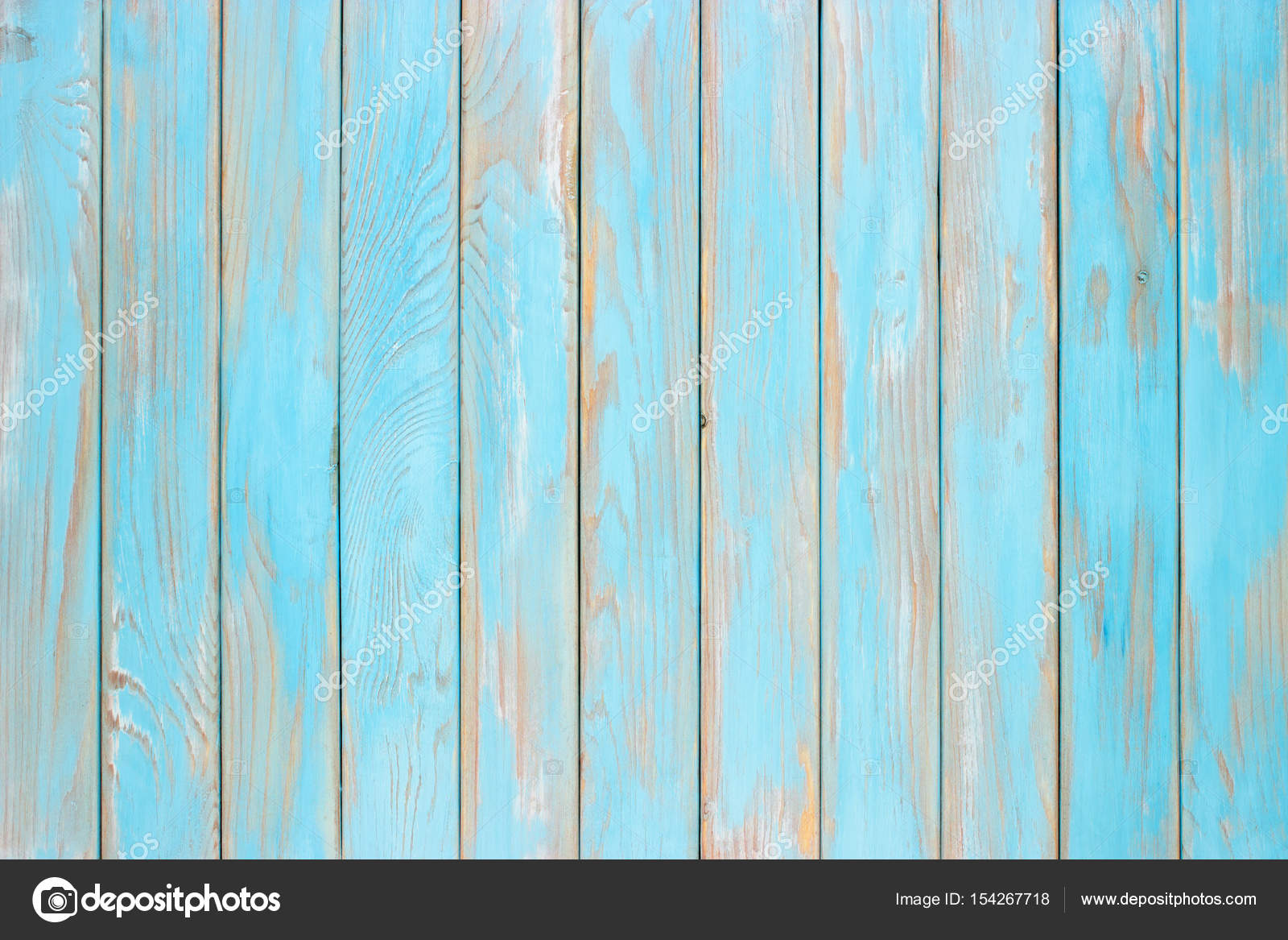 Blue wood planks, a shabby wooden surface of the kitchen table ...