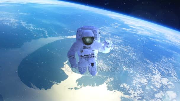 Astronaut nad zemí v otevřeném prostoru
