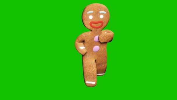 A mézeskalács ember karácsonyi táncot jár. Az ünneplés koncepciója. Looped animáció előtt zöld képernyő.
