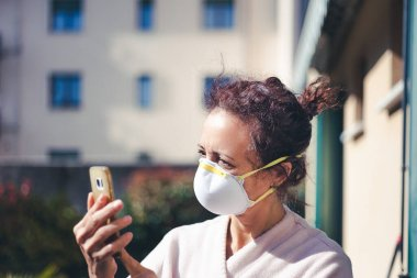 Woman with worried expression, tousled hair and mask for coronavirus quarantine