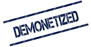 DEMONETIZED blue distressed rubber stamp.