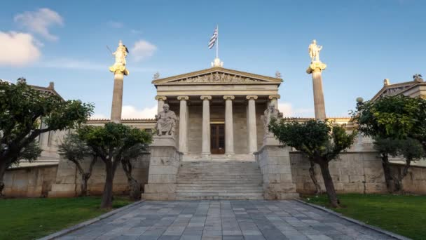 group of tourists visits academy of athens