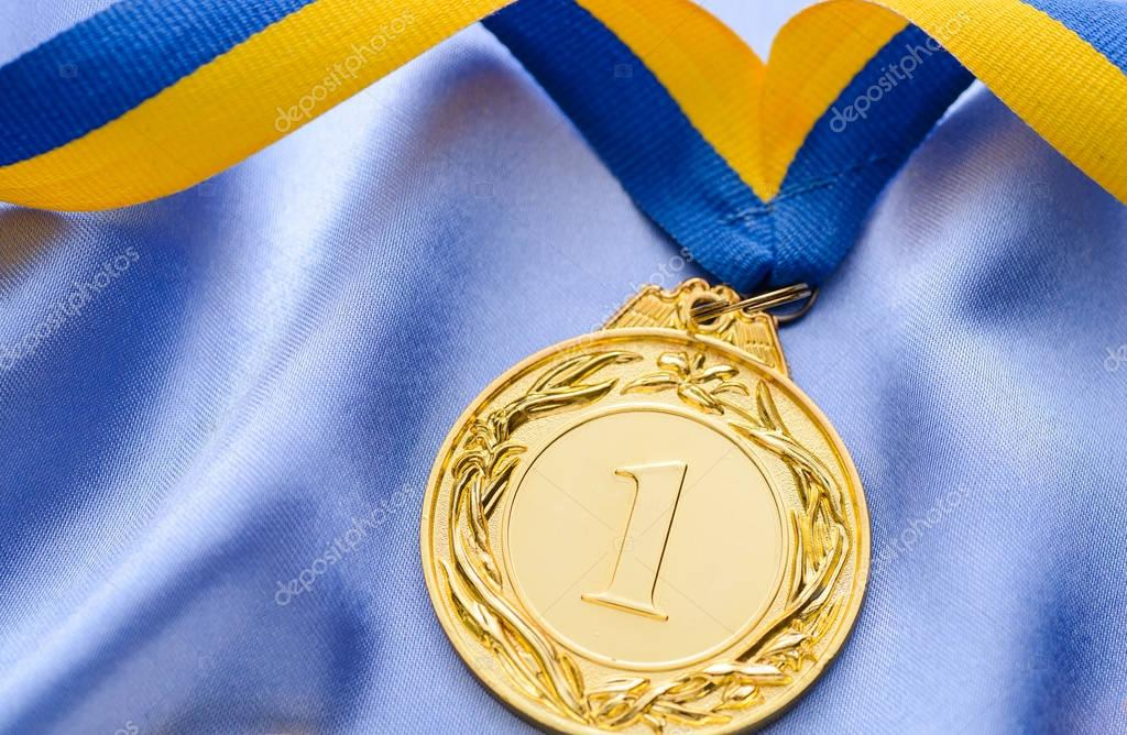Winners gold medal on a ribbon — Stock Photo © serggn ...