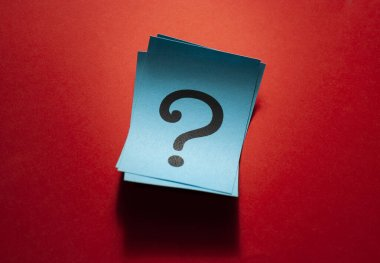 Curled blue paper cards with question marks