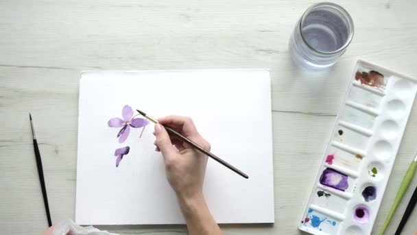 Female artist starting a watercolour painting