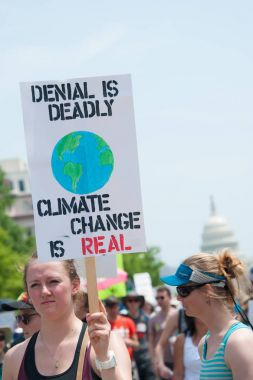 Protester hold sign at Peoples Climate March