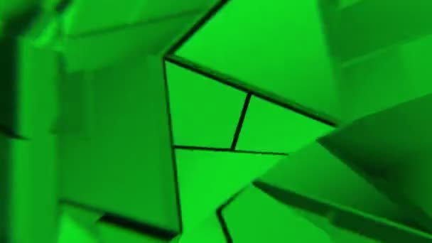 Green abstract polygonal broken shapes fluctuate seamless loop. 3D animation.