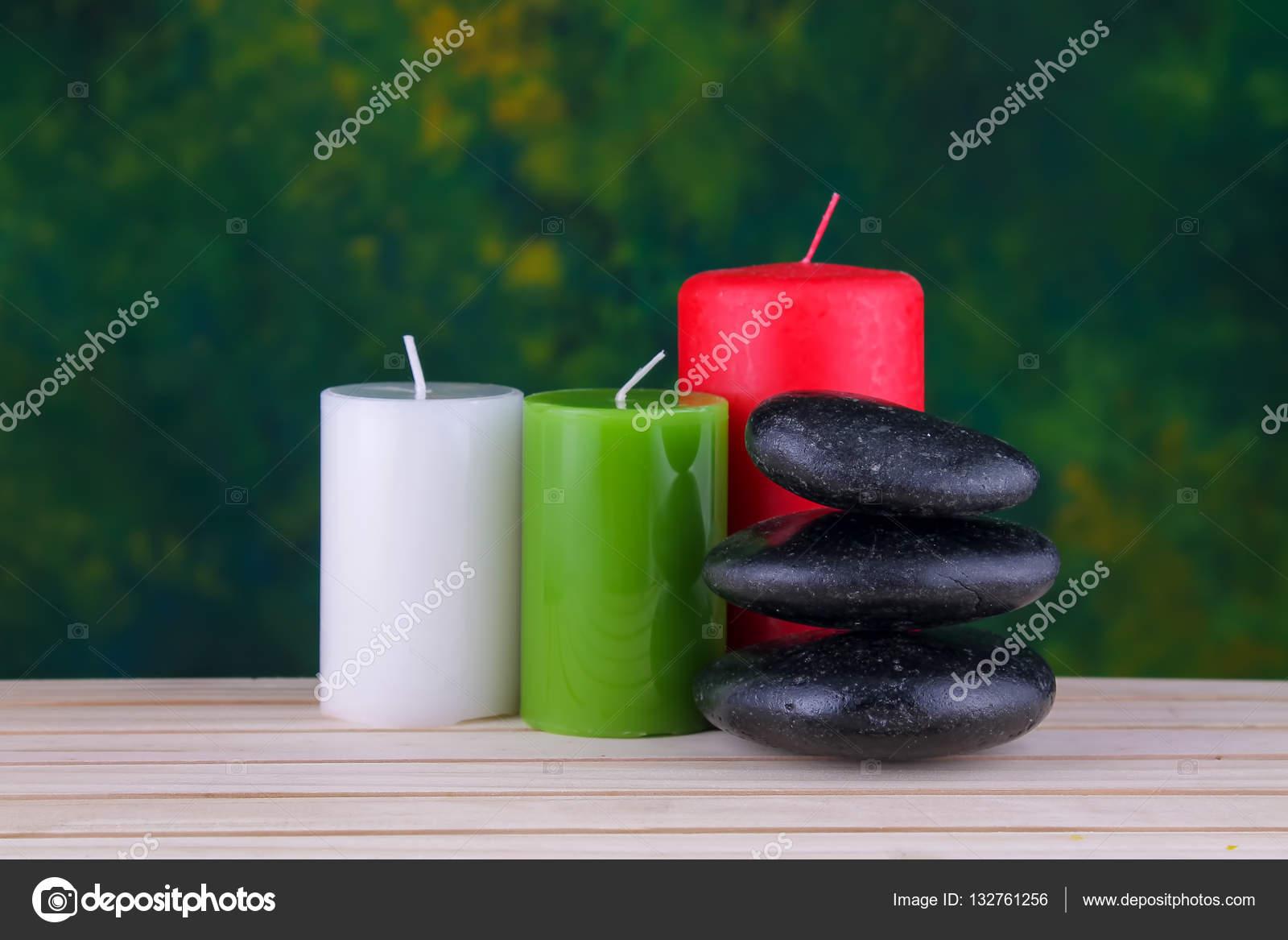 zen basalt stones and candles on the wood stock photo jibamjr