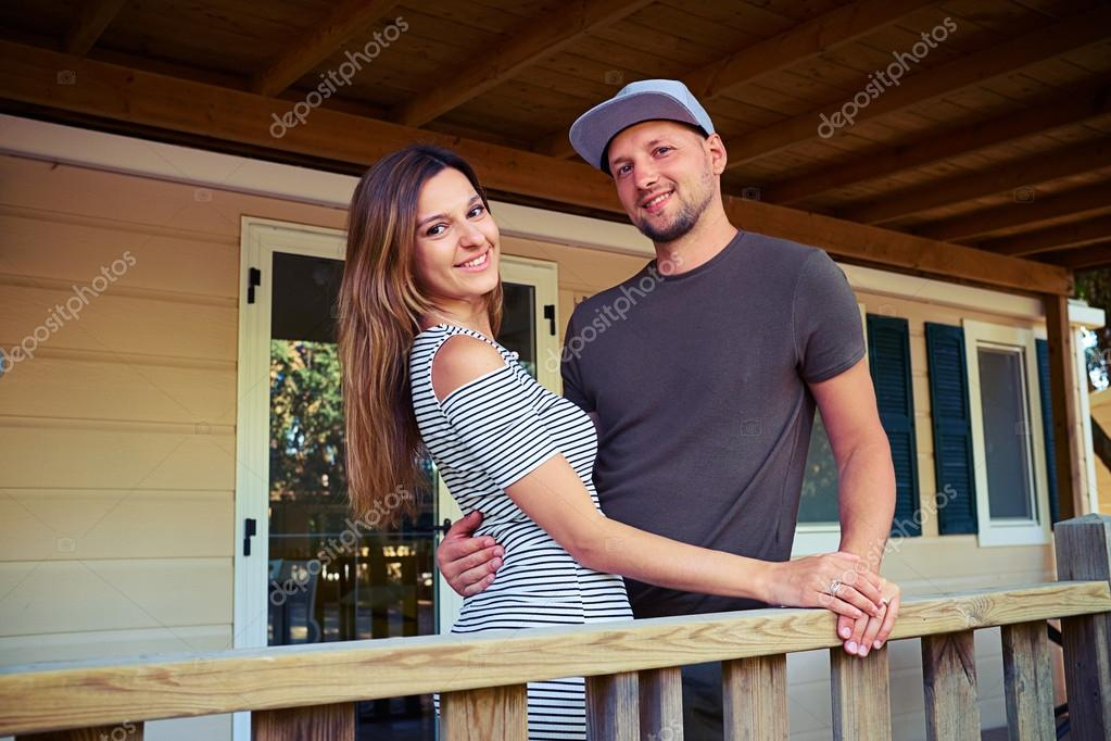 Happy Romantic Couple Hugging Each Other And Posing At A Terrace