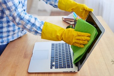 Cropped shot of woman in rubber gloves cleaning with mop display of laptop stock vector