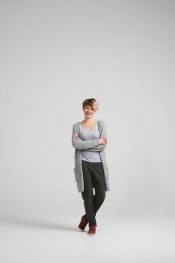 Young woman in casual clothes posing at studio