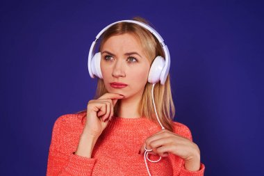 thoughtful blond in headphones