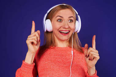blond in headphones listening something interesting
