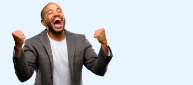 African american man with beard happy and excited celebrating victory expressing big success, power, energy and positive emotions. Celebrates new job joyful isolated over blue background
