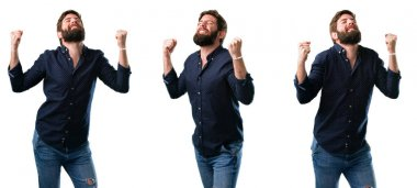 Young man with beard happy and excited expressing winning gesture. Successful and celebrating victory, triumphant isolated over white background