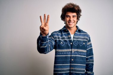 Young handsome man wearing casual shirt standing over isolated white background showing and pointing up with fingers number three while smiling confident and happy.
