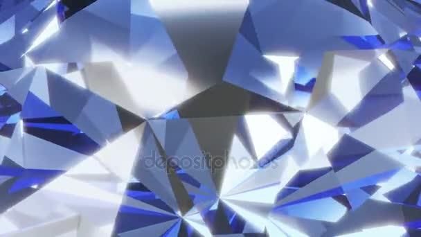 Modrý kosočtverec rotace s zářící paprsky.