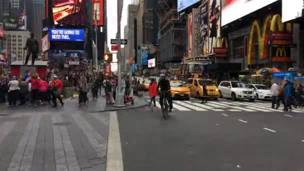 NEW YORK CITY, USA-OCTOBER 2, 2016:Times Square traffic, featured with Broadway Theaters, Sightseeing Buses, Taxi Cabs and animated LED signs, is a symbol of New York City and the United States.