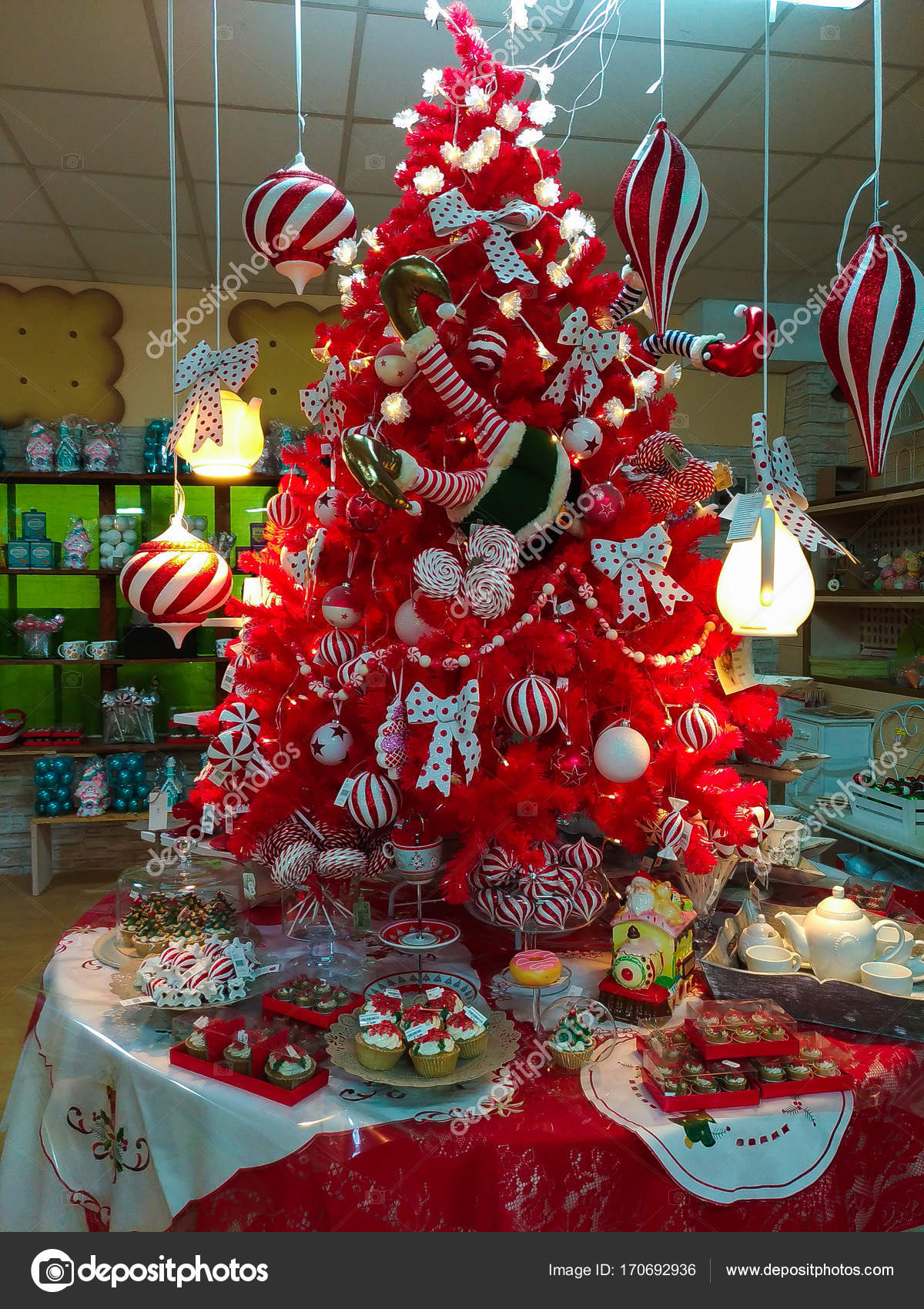 terni italy october 22 2017 red christmas tree with decorations at santa claus village shop in terni photo by buffy1982